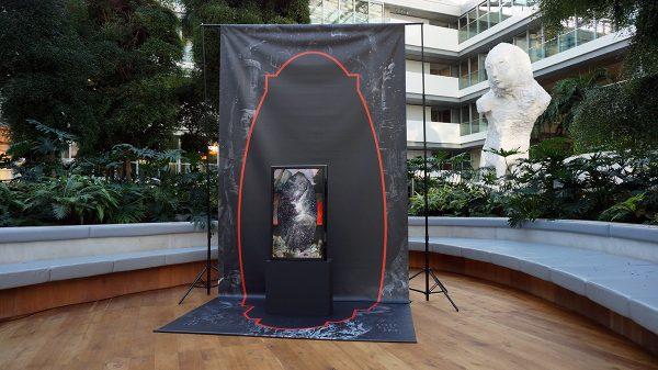 'Galactic Ripple', 2017, Ministerie van Financiën, Den Haag, 2018. Temporary installation in the atrium. Double sided print on vinyl, plinth, flatscreen with animationloop.